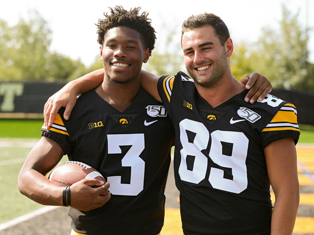 Iowa Hawkeyes wide receiver Tyrone Tracy Jr. (3) and wide receiver Nico Ragaini (89 pose for a photo during Iowa Football Media Day at the Hansen Football Performance Center in Iowa City on Friday, Aug 9, 2019. (Stephen Mally/hawkeyesports.com)