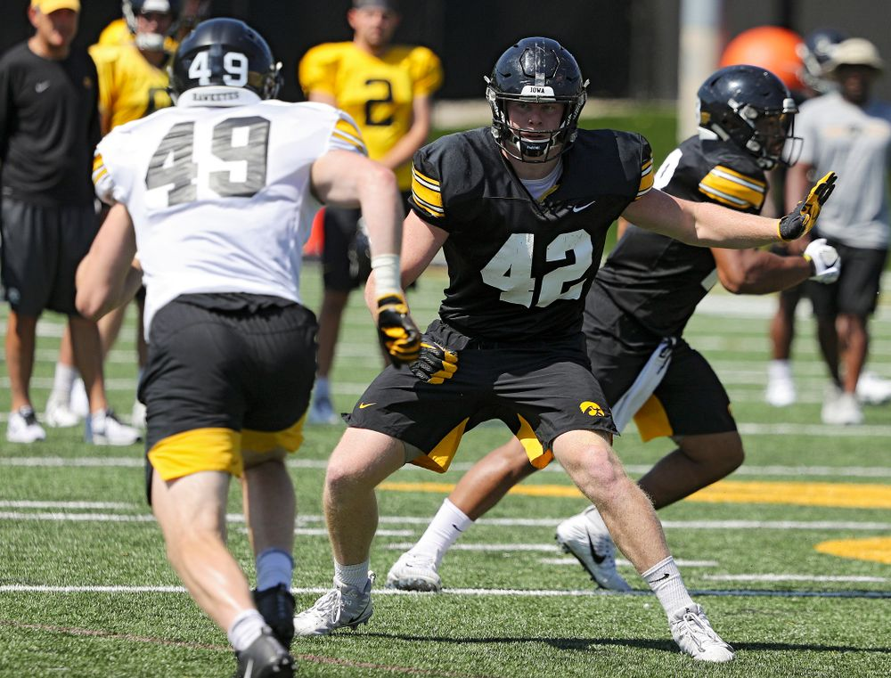Iowa Hawkeyes tight end Shaun Beyer (42) eyes linebacker Nick Niemann (49) during Fall Camp Practice No. 7 at the Hansen Football Performance Center in Iowa City on Friday, Aug 9, 2019. (Stephen Mally/hawkeyesports.com)