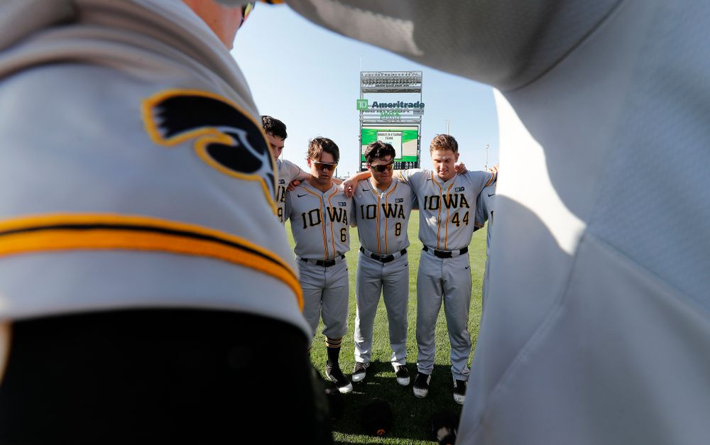 Iowa Hawkeyes outfielder Justin Jenkins (6), outfielder Luke Farley (8), and outfielder Robert Neustrom (44) against the Michigan Wolverines in the first round of the Big Ten Baseball Tournament  Wednesday, May 23, 2018 at TD Ameritrade Park in Omaha, Neb. (Brian Ray/hawkeyesports.com)