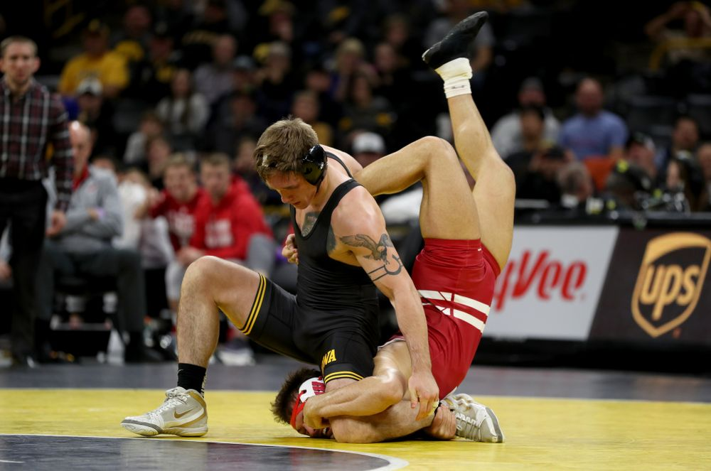 IowaÕs Cash Wilcke wrestles WisconsinÕs Johnny Sebastian at 184 pounds Sunday, December 1, 2019 at Carver-Hawkeye Arena. Sebastian won the match in overtime 7-5. (Brian Ray/hawkeyesports.com)