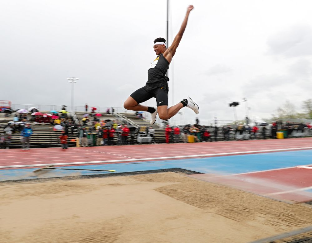 Iowa's James Carter jumps in the men's long jump event on the second day of the Big Ten Outdoor Track and Field Championships at Francis X. Cretzmeyer Track in Iowa City on Saturday, May. 11, 2019. (Stephen Mally/hawkeyesports.com)