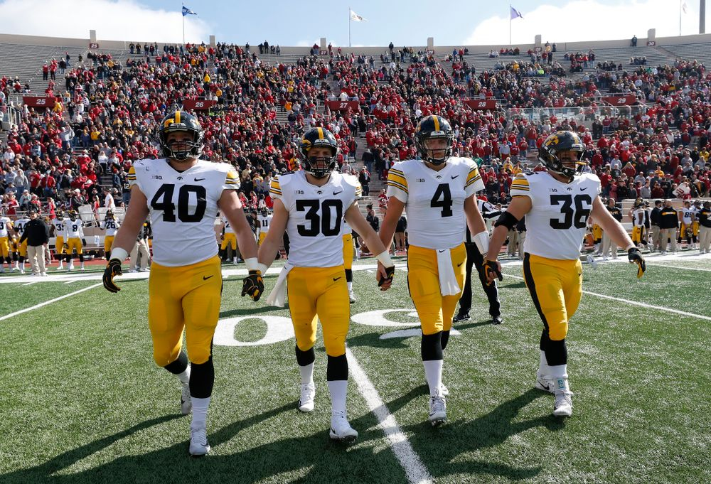 Iowa Hawkeyes captains defensive end Parker Hesse (40), defensive back Jake Gervase (30), quarterback Nate Stanley (4), and fullback Brady Ross against the Indiana Hoosiers Saturday, October 13, 2018 at Memorial Stadium, in Bloomington, Ind. (Brian Ray/hawkeyesports.com)