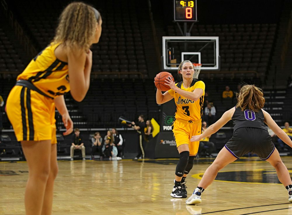 Iowa guard Makenzie Meyer (3) looks to pass to guard Gabbie Marshall (24) during the second quarter of their game against Winona State at Carver-Hawkeye Arena in Iowa City on Sunday, Nov 3, 2019. (Stephen Mally/hawkeyesports.com)