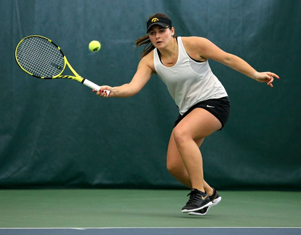 Iowa's Danielle Bauers returns a shot during her doubles match at the Hawkeye Tennis and Recreation Complex in Iowa City on Sunday, February 23, 2020. (Stephen Mally/hawkeyesports.com)