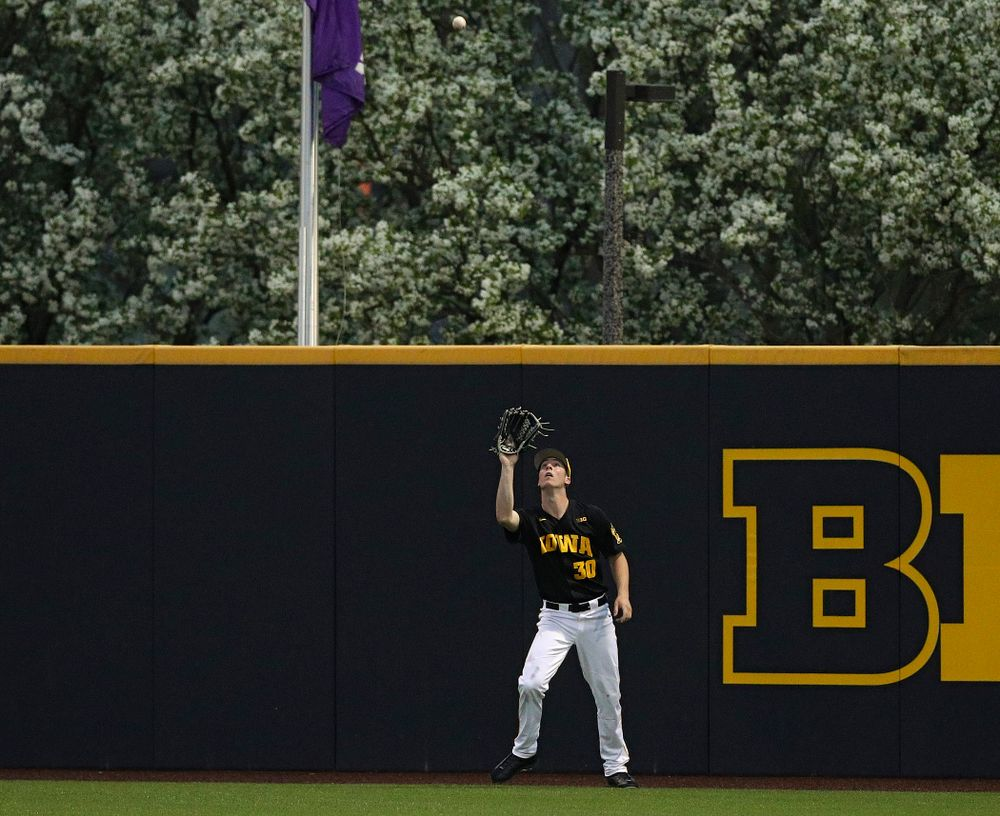 Iowa Hawkeyes right fielder Connor McCaffery (30) looks in a fly ball for an out during the fifth inning of their game against Western Illinois at Duane Banks Field in Iowa City on Wednesday, May. 1, 2019. (Stephen Mally/hawkeyesports.com)
