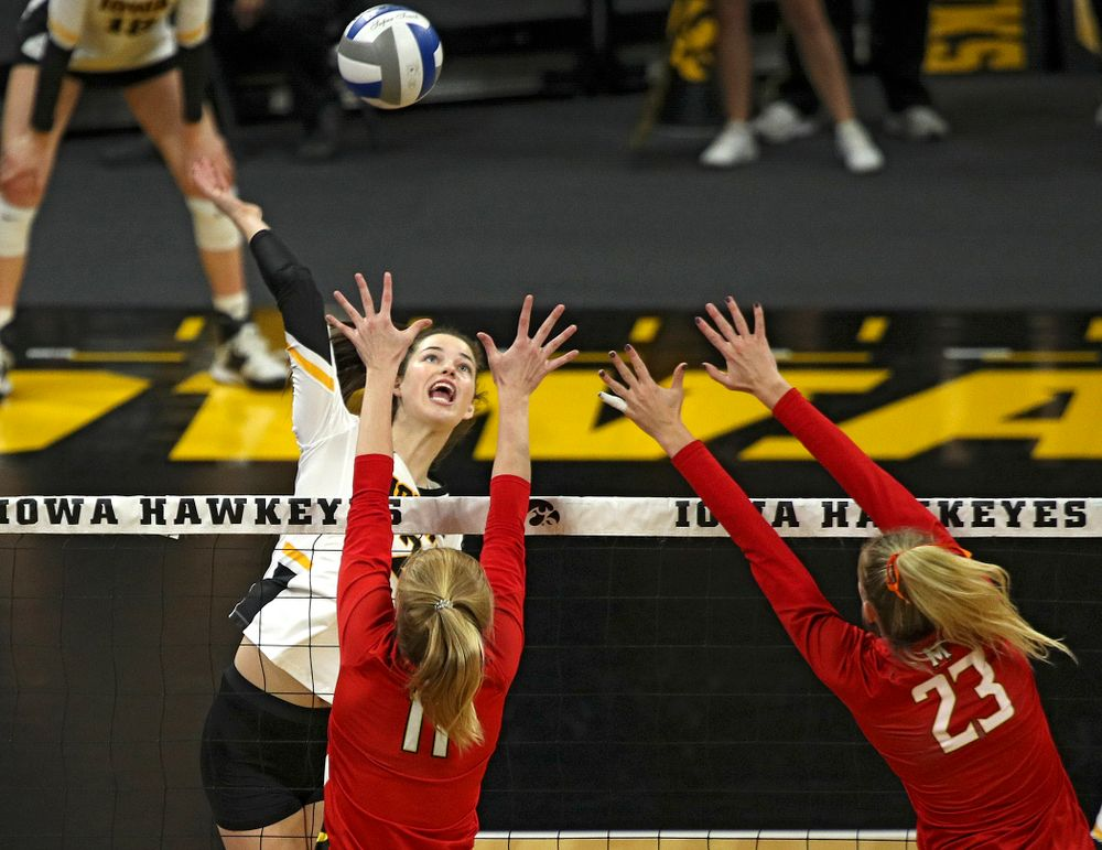 Iowa's Courtney Buzzerio (2) gets up for a kill during the first set of their match at Carver-Hawkeye Arena in Iowa City on Saturday, Nov 30, 2019. (Stephen Mally/hawkeyesports.com)