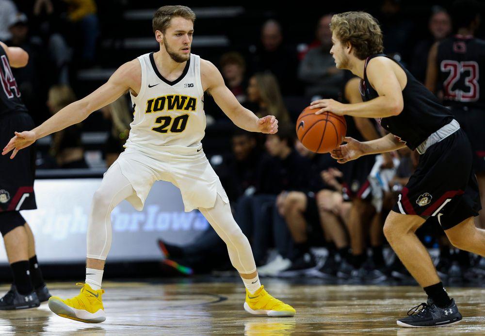 Iowa Hawkeyes forward Riley Till (20) defends during a game against Guilford College at Carver-Hawkeye Arena on November 4, 2018. (Tork Mason/hawkeyesports.com)