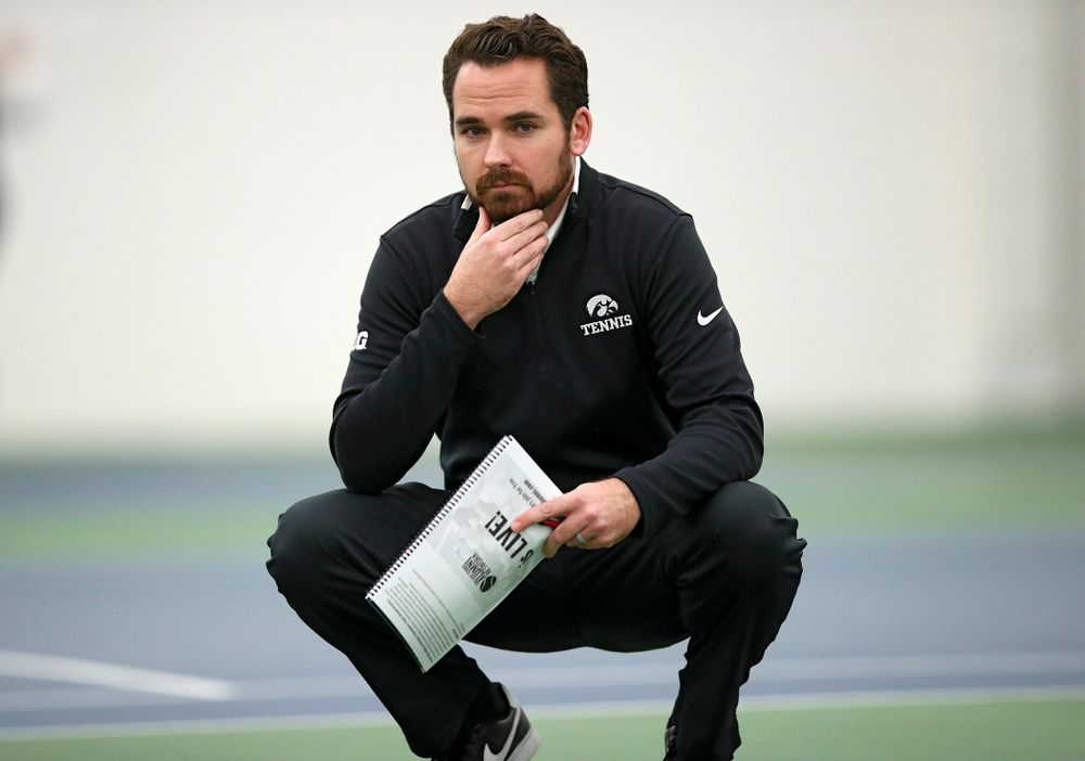 Iowa head coach Ross Wilson looks on during their match at the Hawkeye Tennis and Recreation Complex in Iowa City on Thursday, January 16, 2020. (Stephen Mally/hawkeyesports.com)