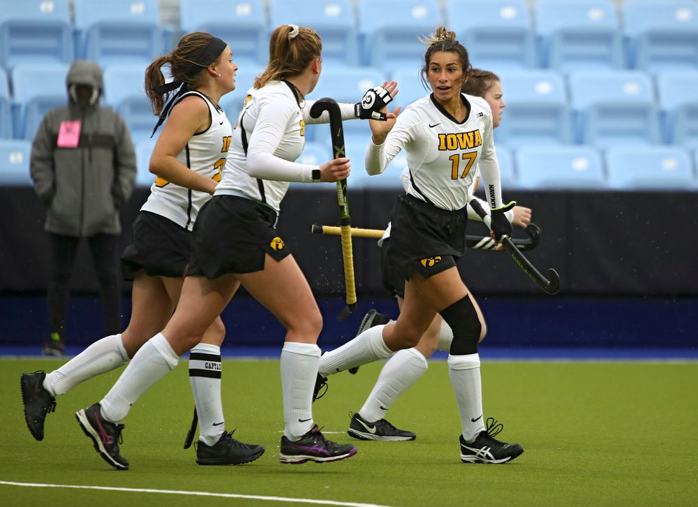 Iowa's Ciara Smith (17) gets a high-five from Makenna Maguire (21) as she runs with Maddy Murphy (26) and Meghan Conroy (5) after Smith scored a goal during the first quarter of their NCAA Tournament First Round match against Duke at Karen Shelton Stadium in Chapel Hill, N.C. on Friday, Nov 15, 2019. (Stephen Mally/hawkeyesports.com)