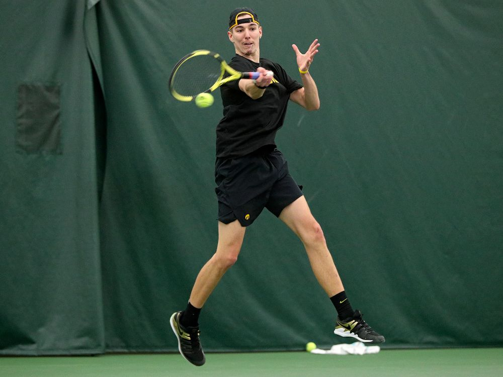 Iowa's Nikita Snezhko returns a shot during his singles match at the Hawkeye Tennis and Recreation Complex in Iowa City on Friday, February 14, 2020. (Stephen Mally/hawkeyesports.com)