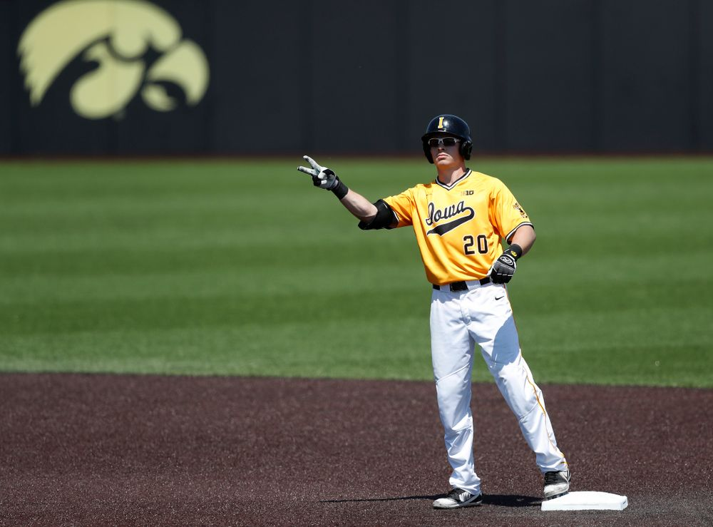 Iowa Hawkeyes catcher Austin Guzzo (20) doubles against the Oklahoma State Cowboys Sunday, May 6, 2018 at Duane Banks Field. (Brian Ray/hawkeyesports.com)
