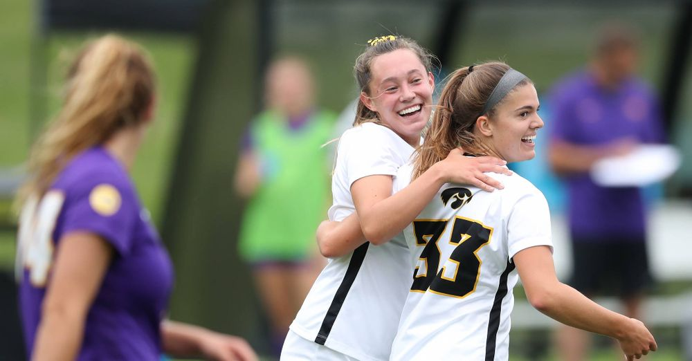 Iowa Hawkeyes forward Skylar Alward (7) celebrates with defender Riley Burns (33) after scoring during a 6-1 win over Northern Iowa Sunday, August 25, 2019 at the Iowa Soccer Complex. (Brian Ray/hawkeyesports.com)