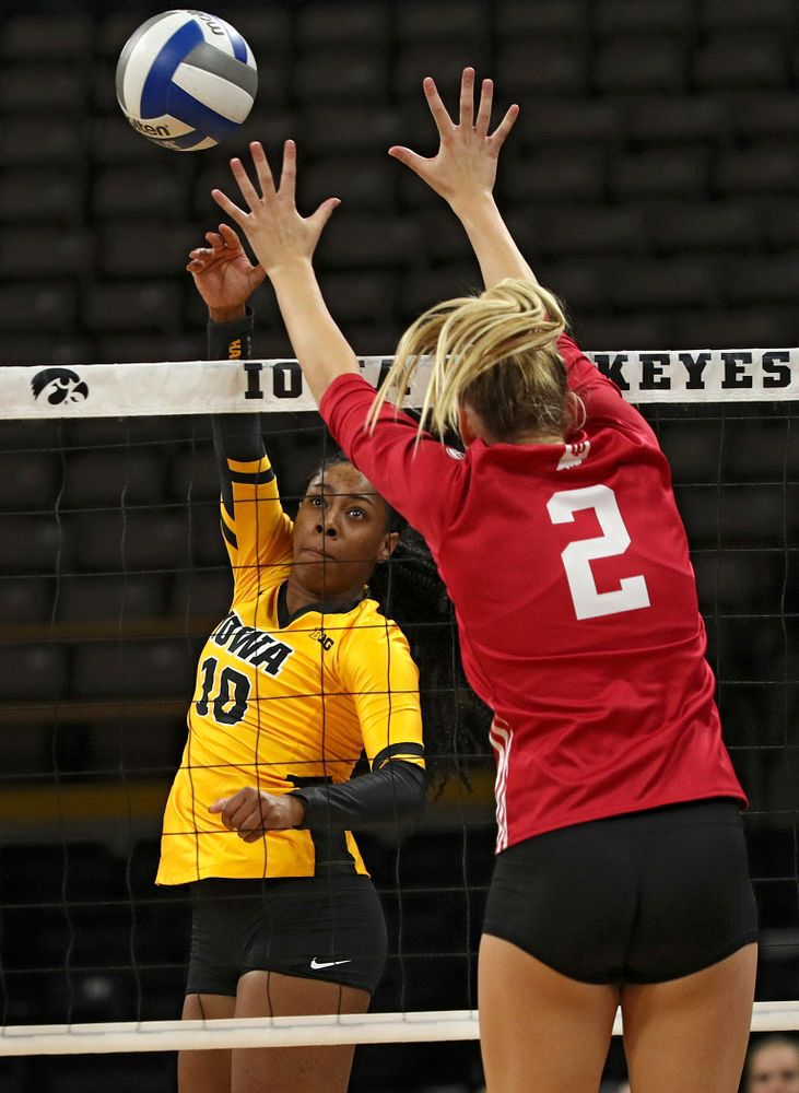 Iowa's Griere Hughes (10) sends the ball over the net during their match at Carver-Hawkeye Arena in Iowa City on Sunday, Oct 20, 2019. (Stephen Mally/hawkeyesports.com)