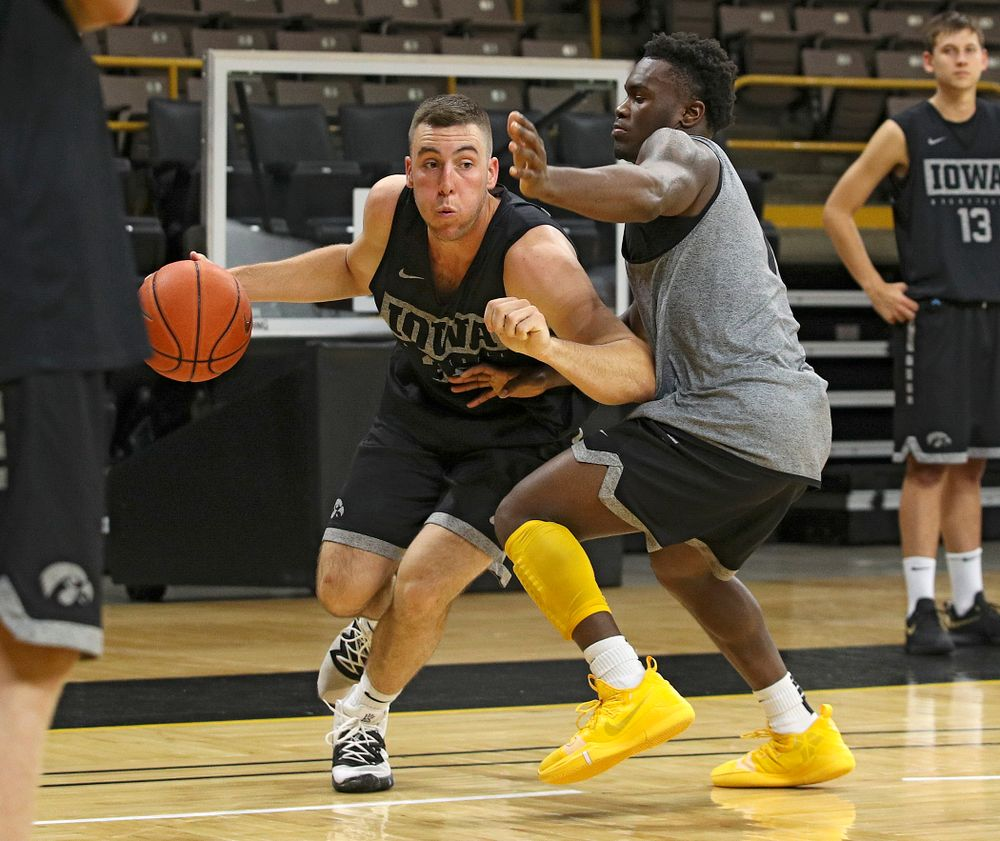 Iowa Hawkeyes guard Connor McCaffery (30) drives on guard Joe Toussaint (1) during practice at Carver-Hawkeye Arena in Iowa City on Monday, Sep 30, 2019. (Stephen Mally/hawkeyesports.com)