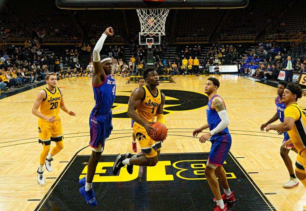 Iowa Hawkeyes guard Joe Toussaint (1) drives into the paint during the second half of their game at Carver-Hawkeye Arena in Iowa City on Monday, Nov 11, 2019. (Stephen Mally/hawkeyesports.com)