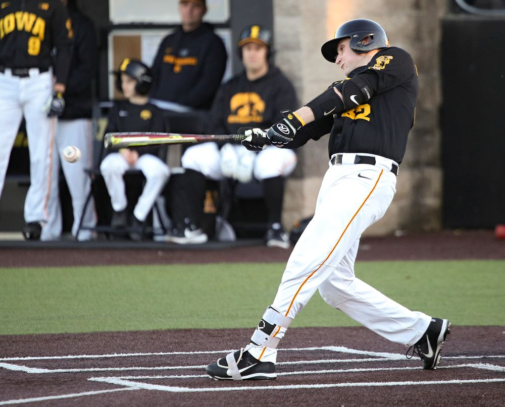Iowa catcher Brett McCleary (32) bats during the fourth inning of their game at Duane Banks Field in Iowa City on Tuesday, March 3, 2020. (Stephen Mally/hawkeyesports.com)