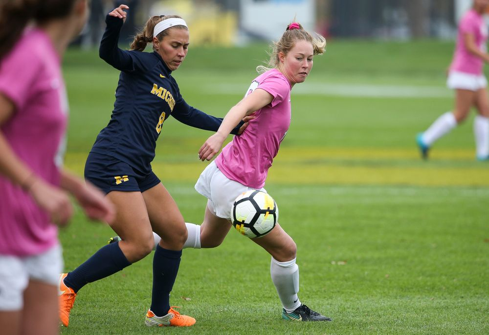 Iowa Hawkeyes midfielder Natalie Winters (10) fights for possession during a game against Michigan at the Iowa Soccer Complex on October 14, 2018. (Tork Mason/hawkeyesports.com)
