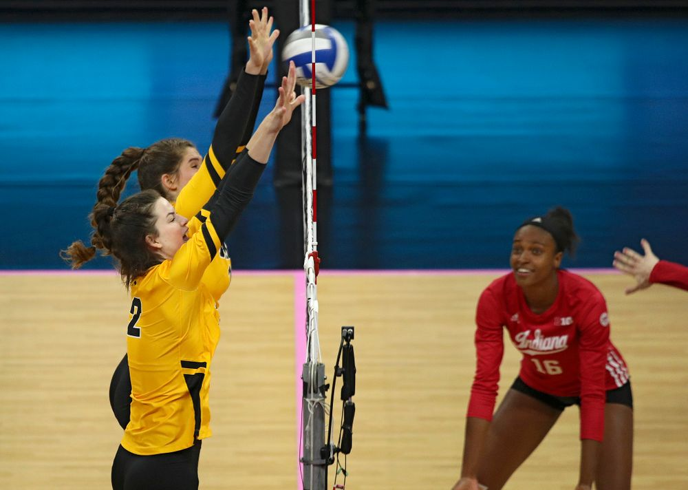 Iowa's Blythe Rients (11) and Courtney Buzzerio (2) get their hands on a shot during their match at Carver-Hawkeye Arena in Iowa City on Sunday, Oct 20, 2019. (Stephen Mally/hawkeyesports.com)