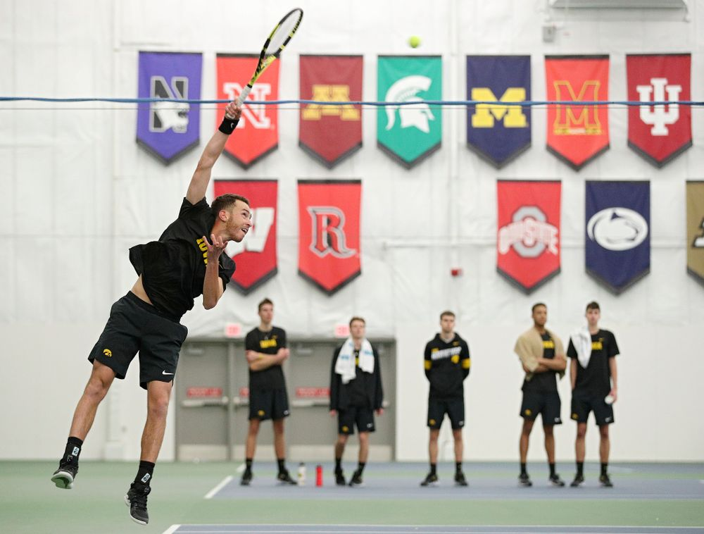 Iowa's Kareem Allaf serves during his match against Marquette at the Hawkeye Tennis and Recreation Complex in Iowa City on Saturday, January 25, 2020. (Stephen Mally/hawkeyesports.com)