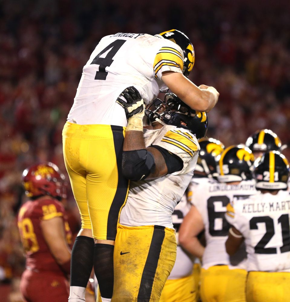 Iowa Hawkeyes quarterback Nate Stanley (4) celebrates with offensive lineman Tristan Wirfs (74) after scoring  against the Iowa State Cyclones Saturday, September 14, 2019 in Ames, Iowa. (Brian Ray/hawkeyesports.com)