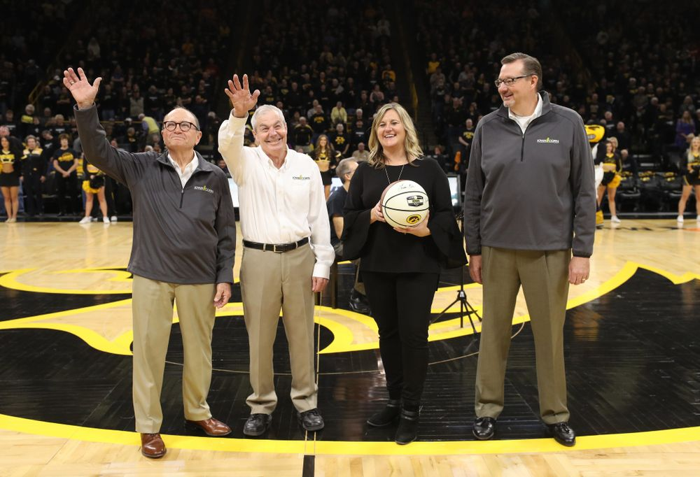 Iowa Corn is presented a signed ball before the Iowa Hawkeyes game against the Iowa State Cyclones in the Iowa Corn Cy-Hawk Series Wednesday, December 5, 2018 at Carver-Hawkeye Arena. (Brian Ray/hawkeyesports.com)