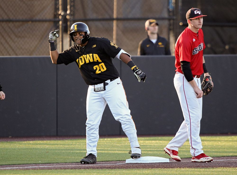 Iowa infielder Izaya Fullard (20) celebrates after hitting a triple during the third inning of their game at Duane Banks Field in Iowa City on Tuesday, March 3, 2020. (Stephen Mally/hawkeyesports.com)