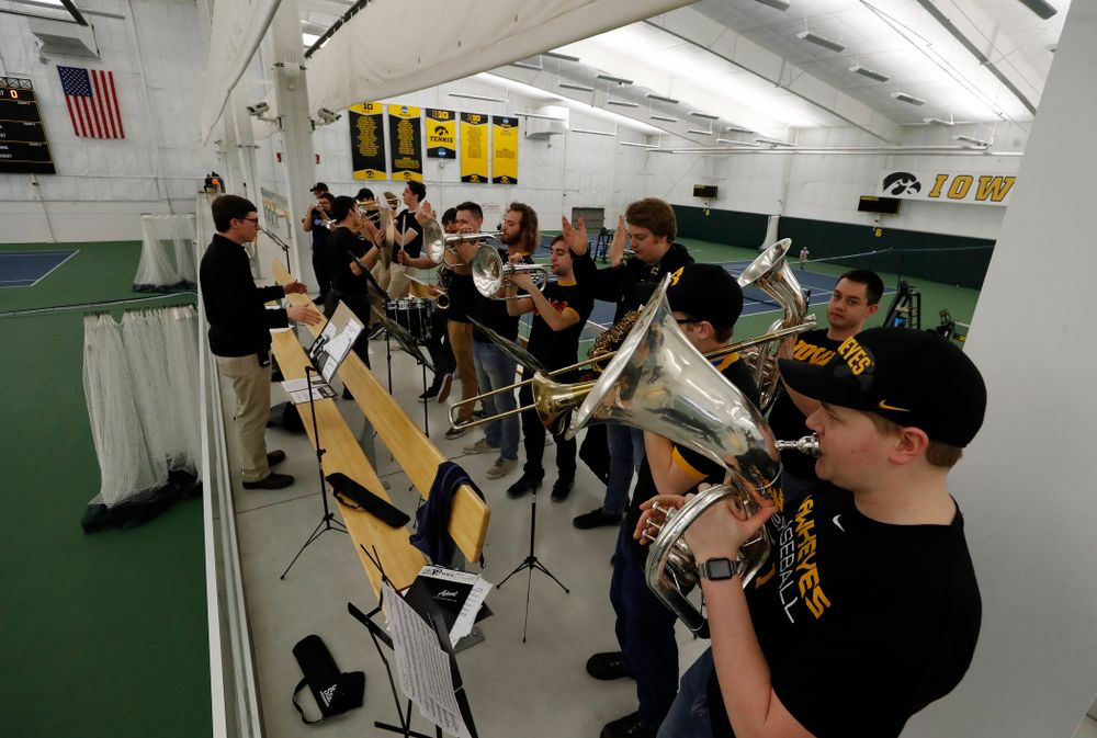 The Iowa Pep Band performs before the Iowa Hawkeyes game  against Purdue Sunday, April 15, 2018 at the Hawkeye Tennis and Recreation Center. (Brian Ray/hawkeyesports.com)