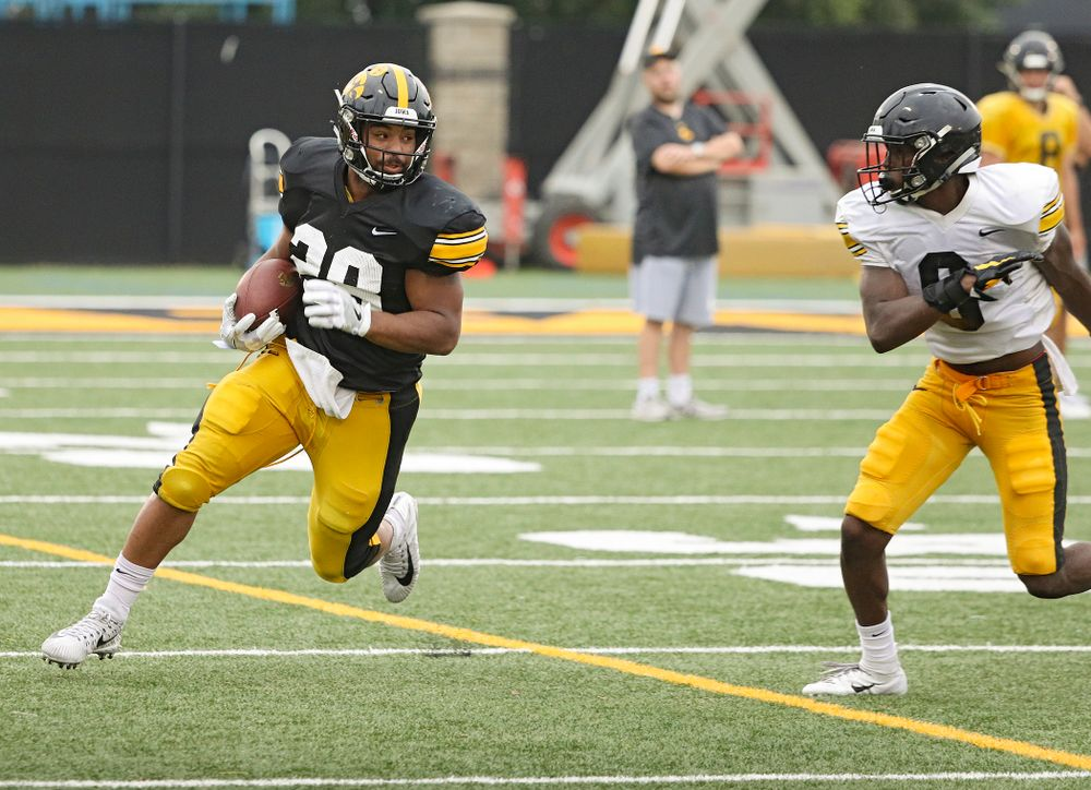 Iowa Hawkeyes running back Toren Young (28) eyes defensive back Matt Hankins (8) on a run durning Fall Camp Practice No. 17 at the Hansen Football Performance Center in Iowa City on Wednesday, Aug 21, 2019. (Stephen Mally/hawkeyesports.com)