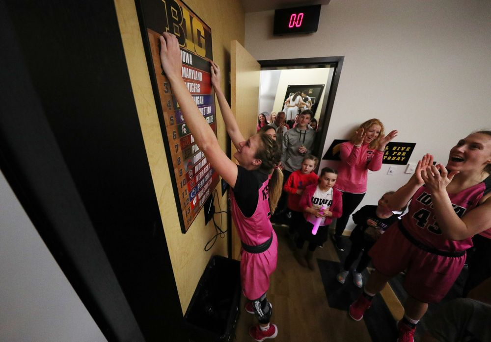 Iowa Hawkeyes guard Makenzie Meyer (3) moves Iowa to the top of the Big Ten standings board in the locker room  following their win against the seventh ranked Maryland Terrapins Sunday, February 17, 2019 at Carver-Hawkeye Arena. (Brian Ray/hawkeyesports.com)