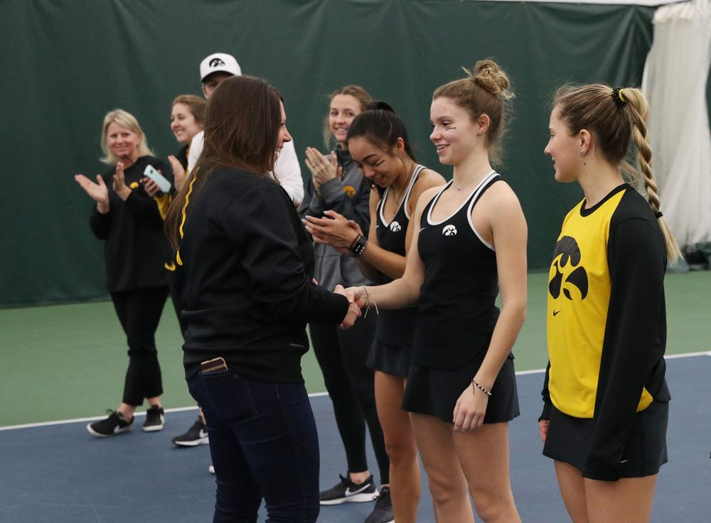Academic Student Services Associate Director Kara Park congratulates Cloe Ruette for earning a 3.0 GPA or better during the fall semester before their match against the Penn State Nittany Lions Sunday, February 24, 2019 at the Hawkeye Tennis and Recreation Complex. (Brian Ray/hawkeyesports.com)