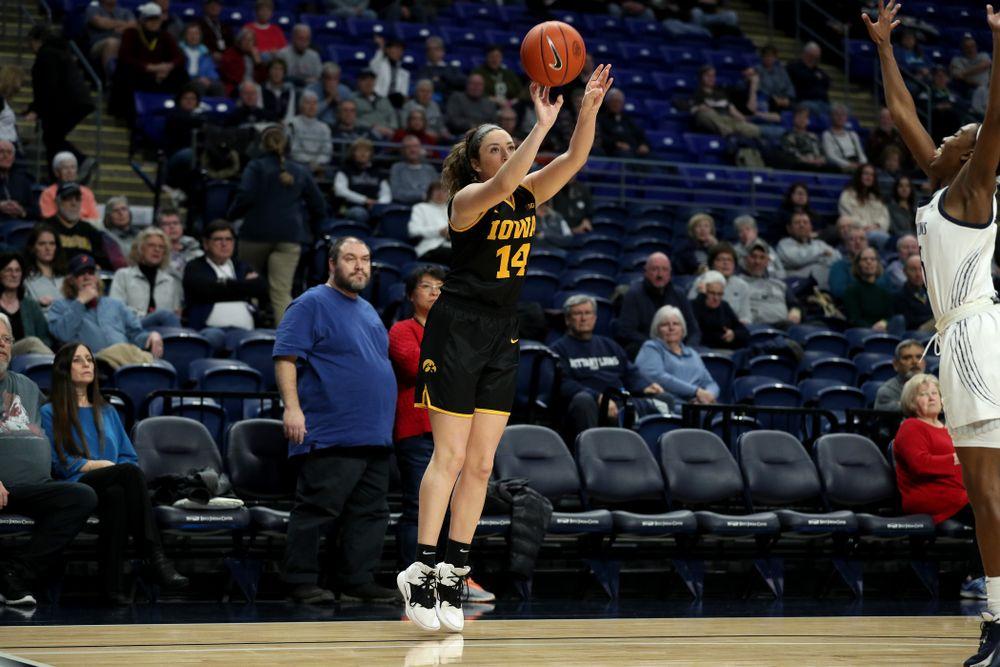 Iowa Hawkeyes forward McKenna Warnock (14) knocks down a three point basket against the Penn State Nittany Lions Thursday, January 30, 2020 at the Bryce Jordan Center. (Brian Ray/hawkeyesports.com)
