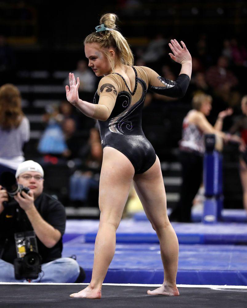 Iowa's Charlotte Sullivan competes on the floor against the Nebraska Cornhuskers