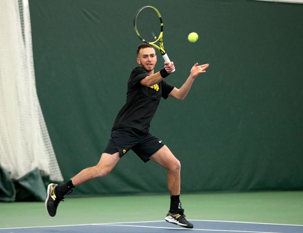 Iowa's Kareem Allaf returns a shot during his doubles match at the Hawkeye Tennis and Recreation Complex in Iowa City on Friday, February 14, 2020. (Stephen Mally/hawkeyesports.com)