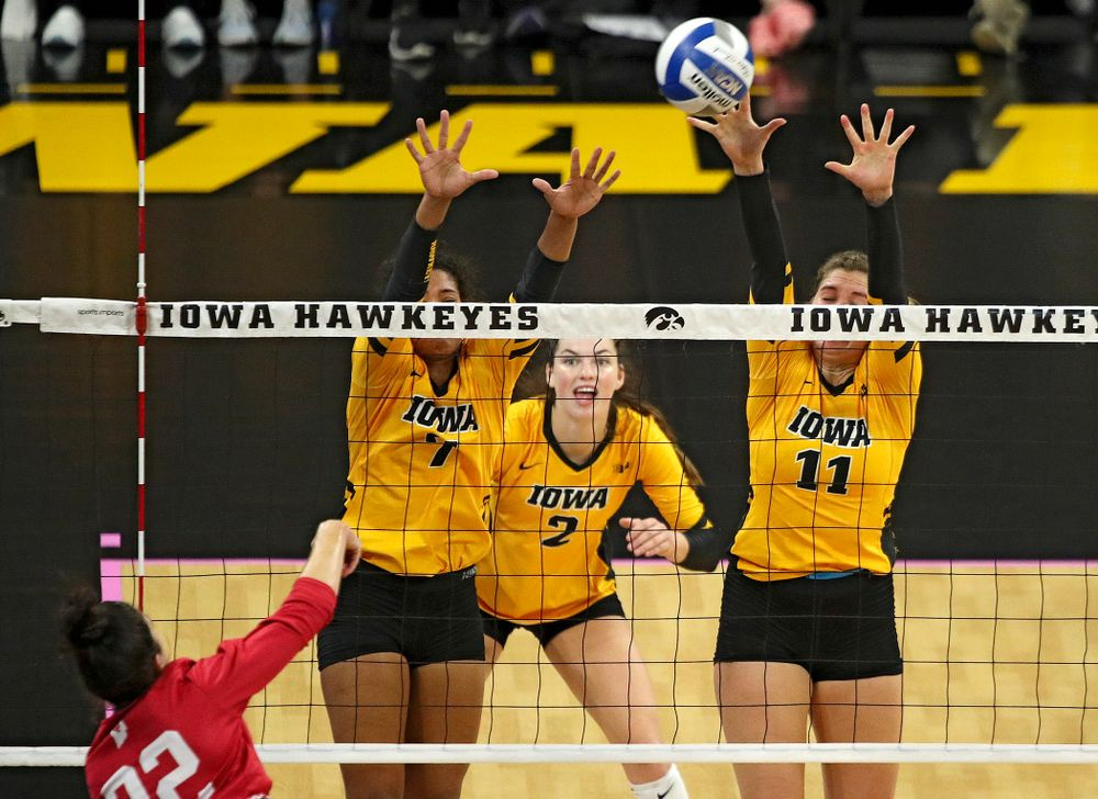 Iowa's Blythe Rients (11) gets a block as Brie Orr (7) and Courtney Buzzerio (2) look on during their match at Carver-Hawkeye Arena in Iowa City on Sunday, Oct 20, 2019. (Stephen Mally/hawkeyesports.com)