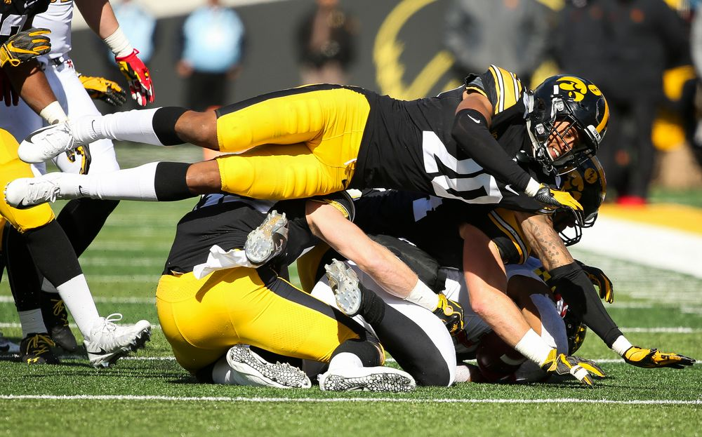 Iowa Hawkeyes defensive back Julius Brents (20) makes a tackle during a game against Maryland at Kinnick Stadium on October 20, 2018. (Tork Mason/hawkeyesports.com)