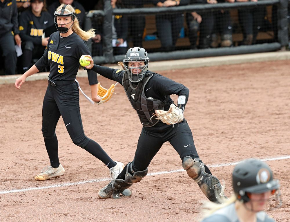 Iowa catcher Abby Lien (9) throws to first base for an out as pitcher Allison Doocy (3) looks on during the fifth inning of their game against Iowa Softball vs Indian Hills Community College at Pearl Field in Iowa City on Sunday, Oct 6, 2019. (Stephen Mally/hawkeyesports.com)