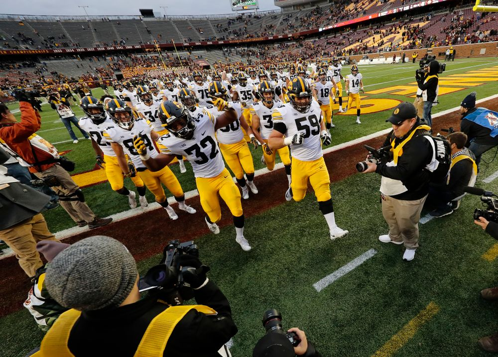 The Iowa Hawkeyes swarm to the Floyd or Rosedale trophy following their victory over the Minnesota Golden Gophers Saturday, October 6, 2018 at TCF Bank Stadium. (Brian Ray/hawkeyesports.com)