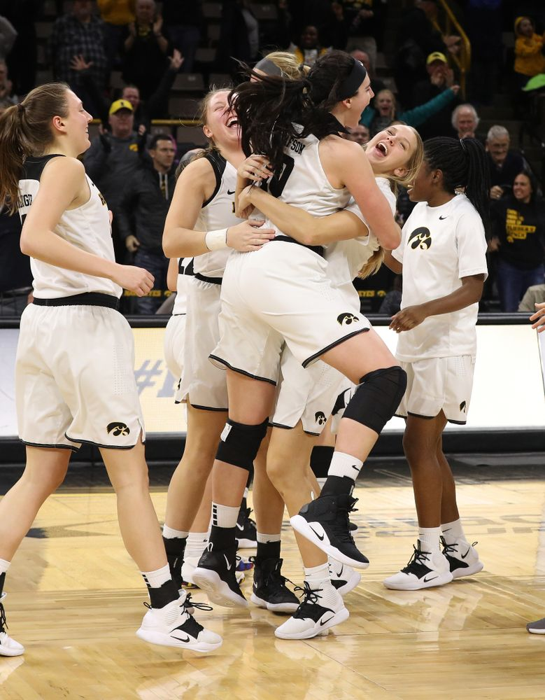 Iowa Hawkeyes forward Megan Gustafson (10) and forward Logan Cook (23) celebrate their victory over the Rutgers Scarlet Knights Wednesday, January 23, 2019 at Carver-Hawkeye Arena. (Brian Ray/hawkeyesports.com)