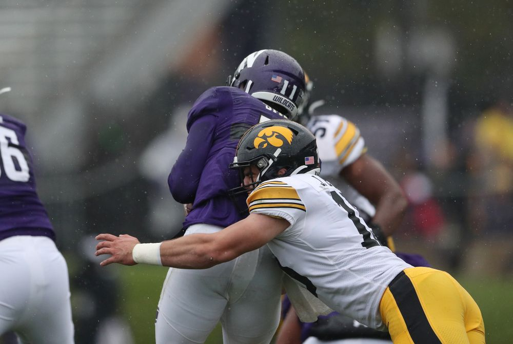 Iowa Hawkeyes linebacker Joe Evans (13) gets his first career sack against the Northwestern Wildcats Saturday, October 26, 2019 at Ryan Field in Evanston, Ill. (Brian Ray/hawkeyesports.com)