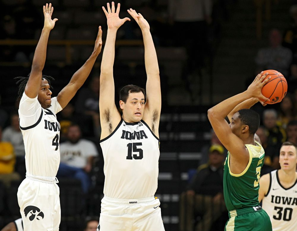 Iowa Hawkeyes guard Bakari Evelyn (4) and forward Ryan Kriener (15) pressure Cal Poly Mustangs guard Colby Rogers (3) during the first half of their game at Carver-Hawkeye Arena in Iowa City on Sunday, Nov 24, 2019. (Stephen Mally/hawkeyesports.com)