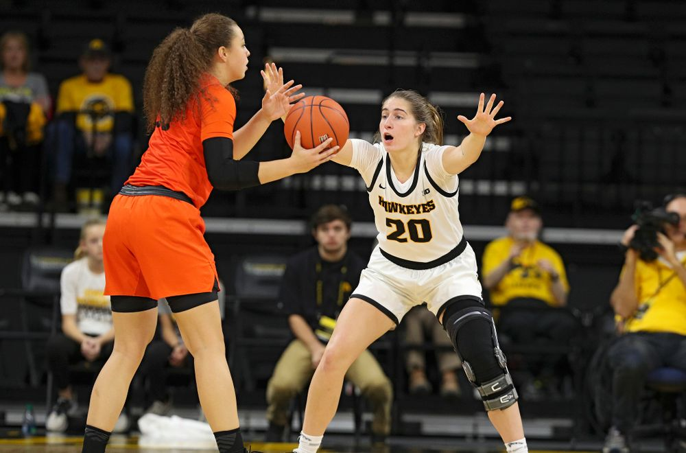 Iowa guard Kate Martin (20) defends during the second quarter of their overtime win against Princeton at Carver-Hawkeye Arena in Iowa City on Wednesday, Nov 20, 2019. (Stephen Mally/hawkeyesports.com)