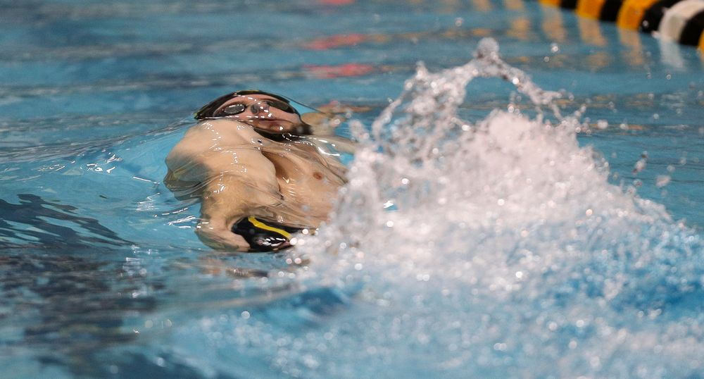 Iowa's Kenneth Mende competes in the 100-yard backstroke during the third day of the Hawkeye Invitational at the Campus Recreation and Wellness Center on November 16, 2018. (Tork Mason/hawkeyesports.com)