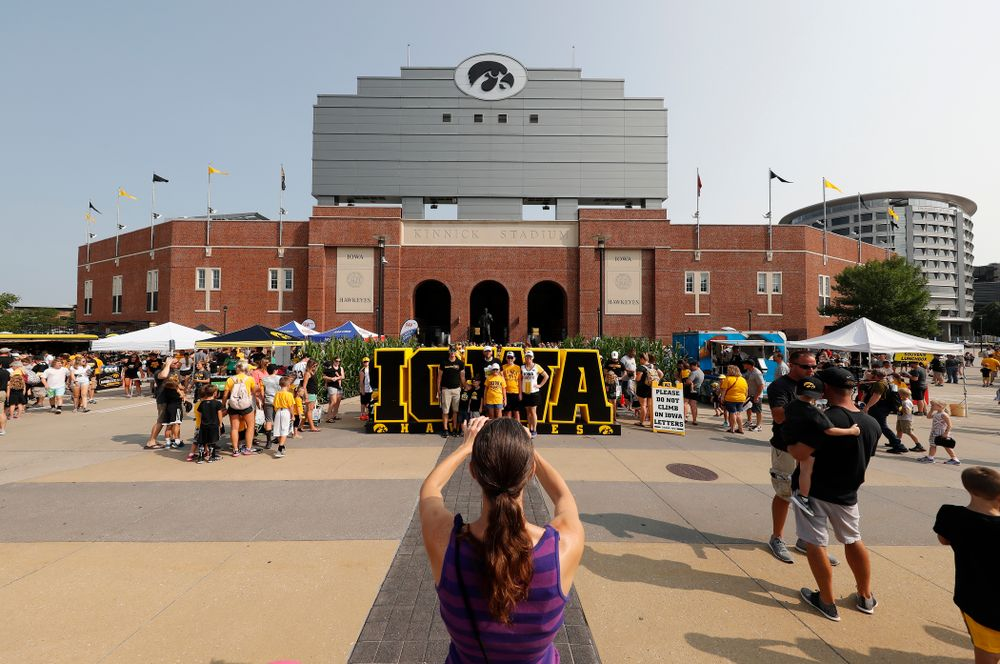 Fans take photos during Kids Day Saturday, August 11, 2018 at Kinnick Stadium. (Brian Ray/hawkeyesports.com)