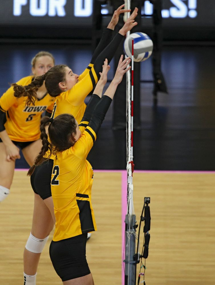 Iowa's Blythe Rients (11) blocks a shot as Courtney Buzzerio (2) looks on during their match at Carver-Hawkeye Arena in Iowa City on Sunday, Oct 20, 2019. (Stephen Mally/hawkeyesports.com)