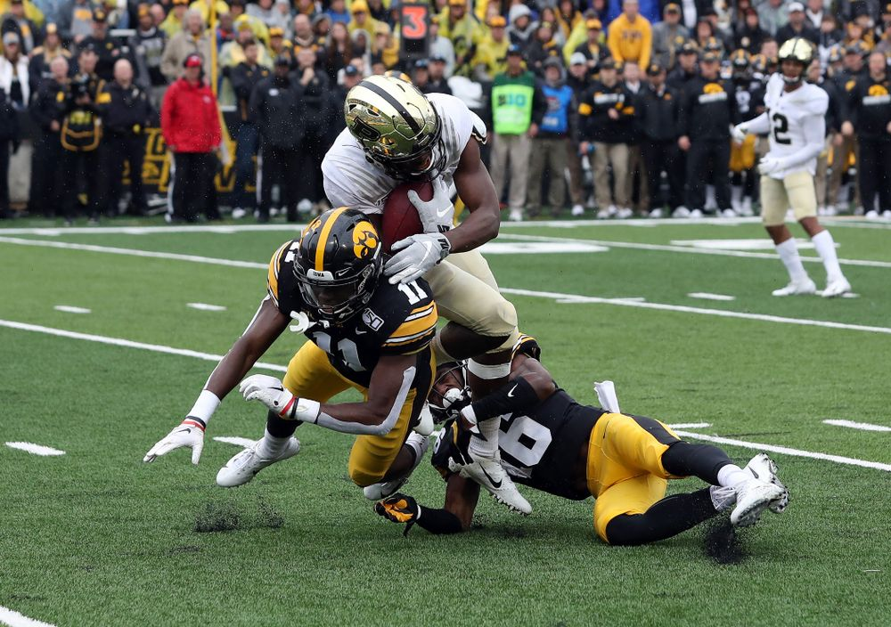 Iowa Hawkeyes defensive back Michael Ojemudia (11) and defensive back Terry Roberts (16) against the Purdue Boilermakers Saturday, October 19, 2019 at Kinnick Stadium. (Brian Ray/hawkeyesports.com)