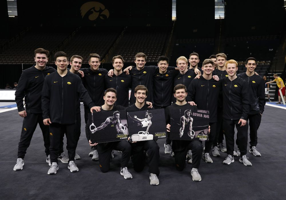 Iowa Men's Gymnastics seniors Jake Brodarzon, Kevin Johnson, and Rogelio Vazquez during senior day ceremonies following their meet against the Ohio State Buckeyes  Saturday, March 16, 2019 at Carver-Hawkeye Arena.  (Brian Ray/hawkeyesports.com)