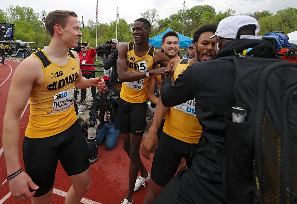 Iowa's Chris Thompson (from left), Wayne Lawrence Jr., Carter Lilly, and May'yea Harris celebrate after winning the 1600 meter relay event on the third day of the Big Ten Outdoor Track and Field Championships at Francis X. Cretzmeyer Track in Iowa City on Sunday, May. 12, 2019. (Stephen Mally/hawkeyesports.com)