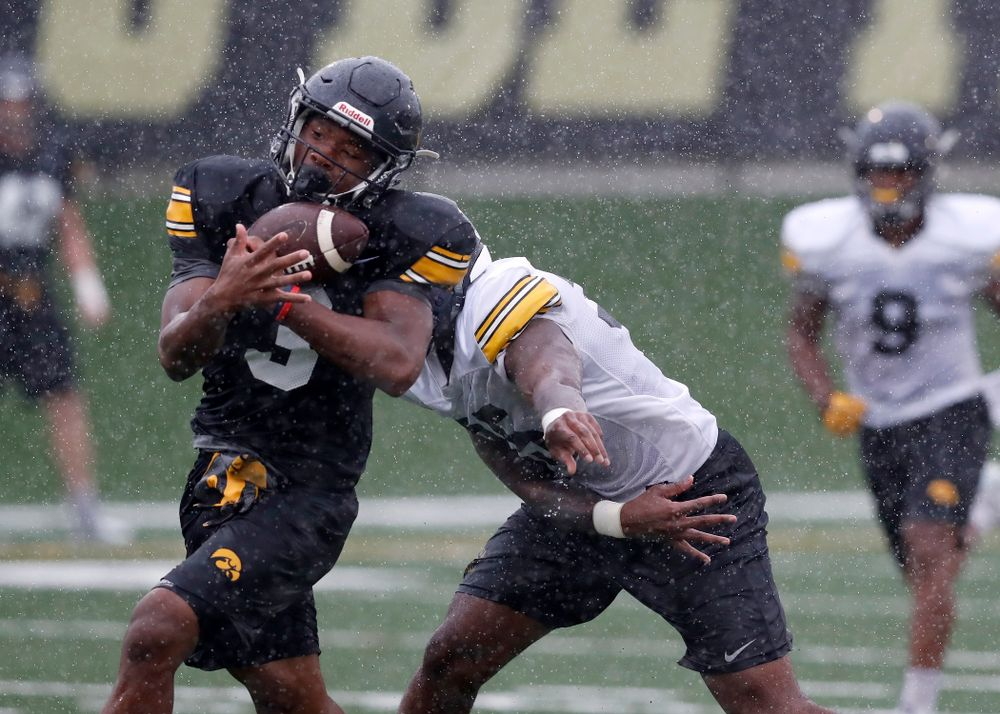 Iowa Hawkeyes wide receiver Tyrone Tracy Jr. (3) and linebacker Barrington Wade (35) during camp practice No. 15  Monday, August 20, 2018 at the Hansen Football Performance Center. (Brian Ray/hawkeyesports.com)
