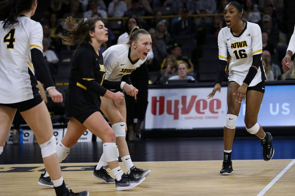 Iowa Hawkeyes defensive specialist Molly Kelly (1) and Iowa Hawkeyes outside hitter Cali Hoye (14) celebrate after winning a point during a match against Penn State at Carver-Hawkeye Arena on November 3, 2018. (Tork Mason/hawkeyesports.com)