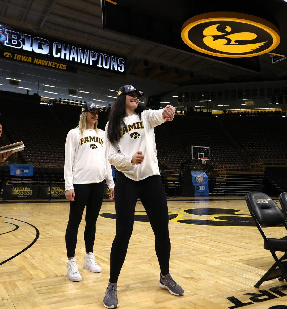 Iowa Hawkeyes forward Megan Gustafson (10) and forward Hannah Stewart (21) during a celebration of their Big Ten Women's Basketball Tournament championship Monday, March 18, 2019 at Carver-Hawkeye Arena. (Brian Ray/hawkeyesports.com)